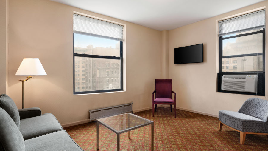 alt-text Standard Non Smoking Jr. Suite are spacious and feature a living room with sofas and a table