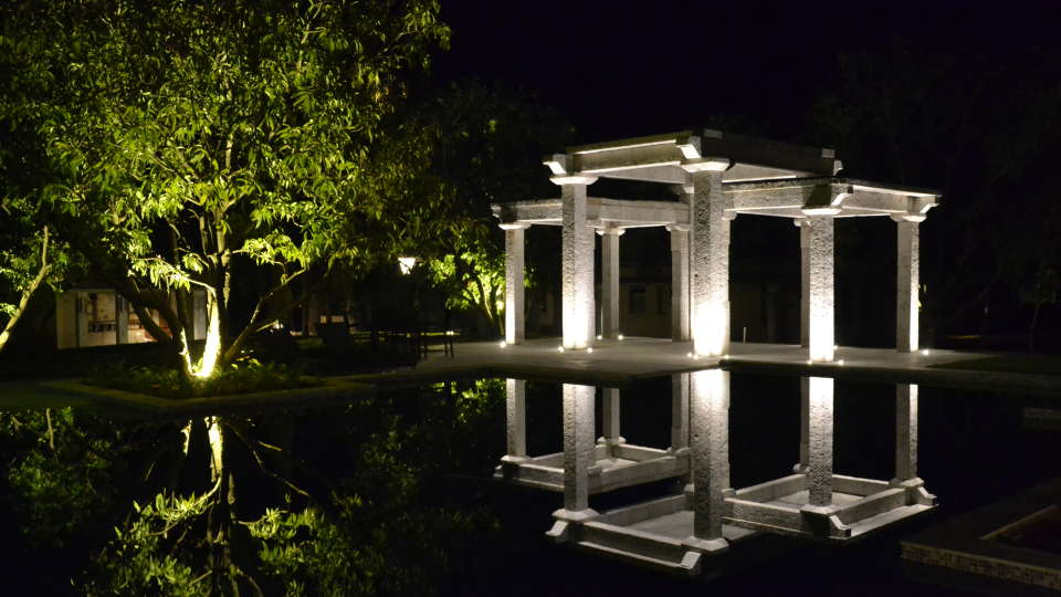 A Decorative Arch Overlooking the Pool at Hotel Heritage Resort Hampi