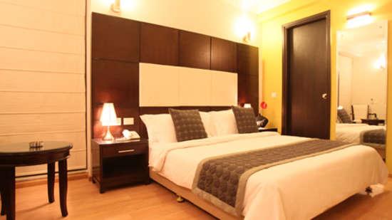 Emblem Hotel, New Friends Colony, New Delhi Delhi bedroom emblem Hotel nfc new delhi