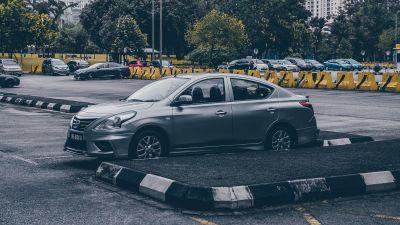 silver-sedan-parked-in-parking-lot-3795937