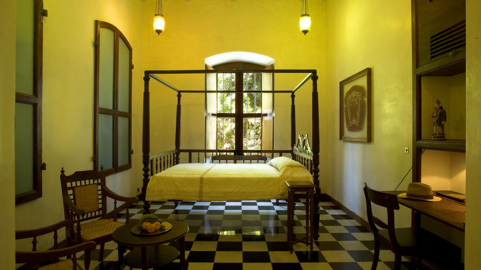 Le Dupleix - antique french furniture high wooden ceiling large windows send out a warm lived in feel a