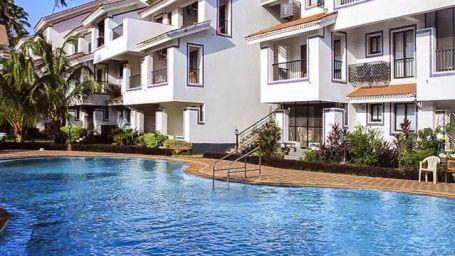 Casa Legend Villa & Serviced Apartments, Goa Goa Pool with Studio in the background