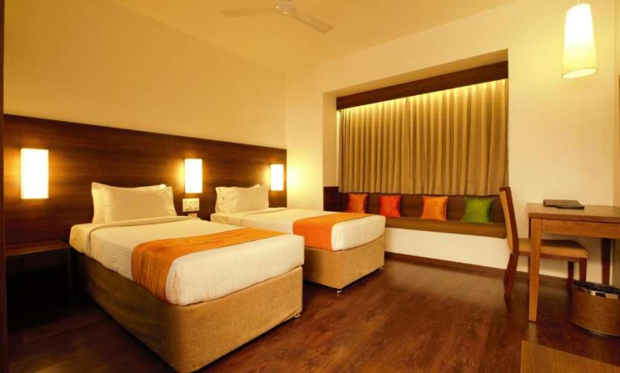 alt-text Temple Tree Hotel near Christ University, Temple Tree Hotel near NIMHANS Hospital Bangalore, best hotel near Christ University and NIMHANS Hospital near Hosur RoadRooms at Temple Tree, Hotel Near Lalbagh, Rooms In Lakkasandra 3