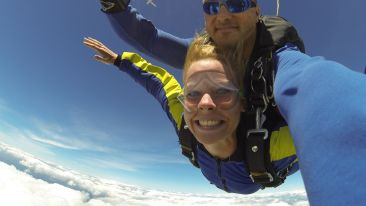 fisheye-photography-of-man-and-woman-sky-diving-739568