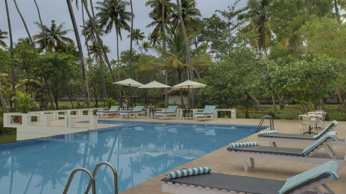 pool from rest view, Contact Beach Resort in Marari, Beach resorts in Allepey, 4 Star Resorts in Alleppey, Best Beach Resorts in Alleppey, Best Beach Resorts Near Cochin, Beach Resorts in Kerala