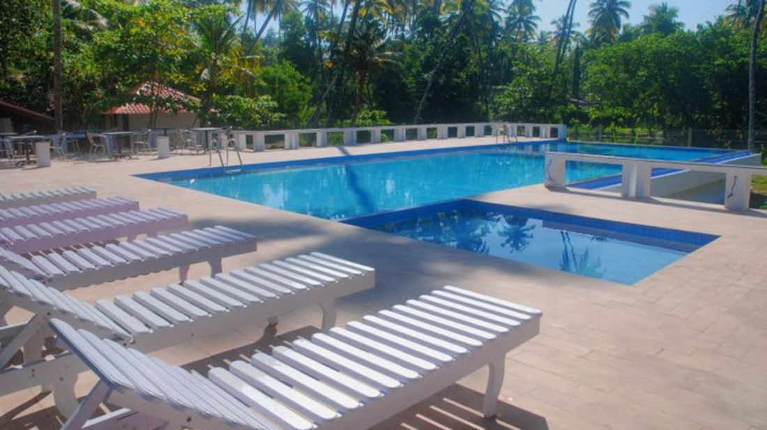 abad-turtle-resort-large-swimming-pool-with-baby-pool, Contact Beach Resort in Marari, Beach resorts in Allepey, 4 Star Resorts in Alleppey, Best Beach Resorts in Alleppey, Best Beach Resorts Near Cochin, Beach Resorts in Kerala
