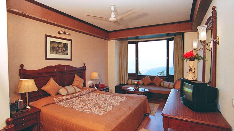 Sun n Snow Inn Hotel Kausani Kausani Deluxe Room 1 Sun n Snow Inn hotels in kausani, Uttarakhand hotels, kausani hotels 59595