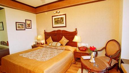 Sun n Snow Inn Hotel Kausani Kausani Deluxe Room Sun n Snow Inn hotels in kausani, Uttarakhand hotels, kausani hotels 9595