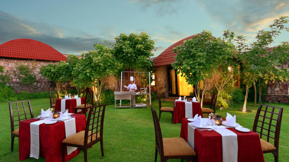 Tables arranged on the grreen garden outside our suites in Udaipur