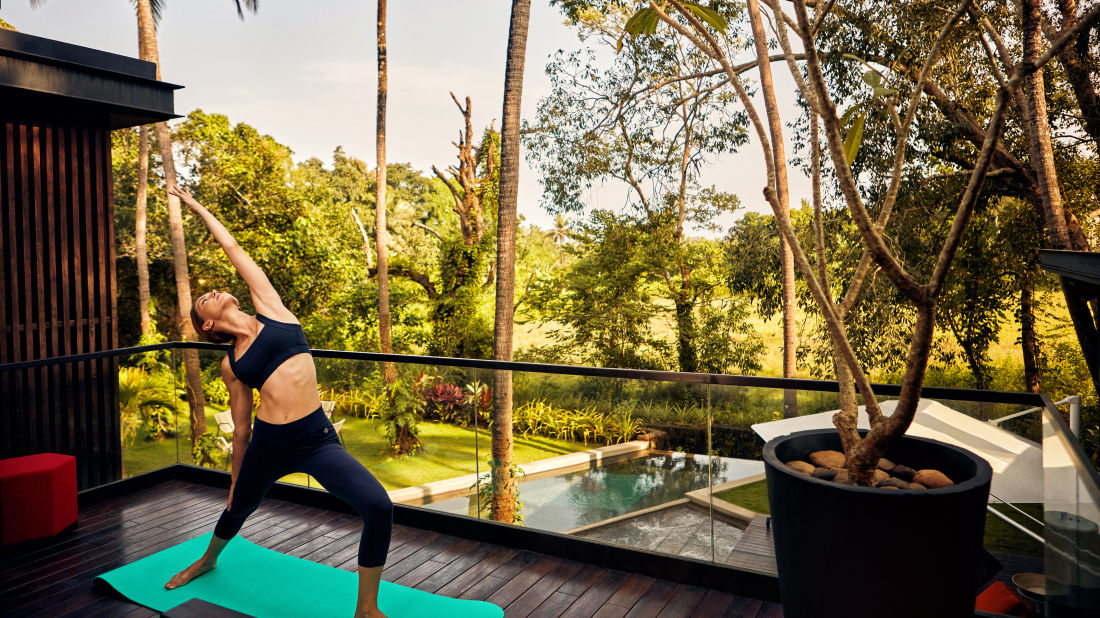 Woman doing yoga and relaxing at the villa in Calangute - Villa in Palms by Vescapes