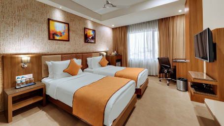 Deluxe Twin Bed at Anaya Beacon Hotel in Jamnagar 2