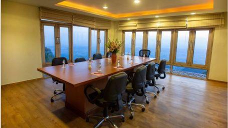 The library Moksha Himalaya Spa Resort Parwanoo