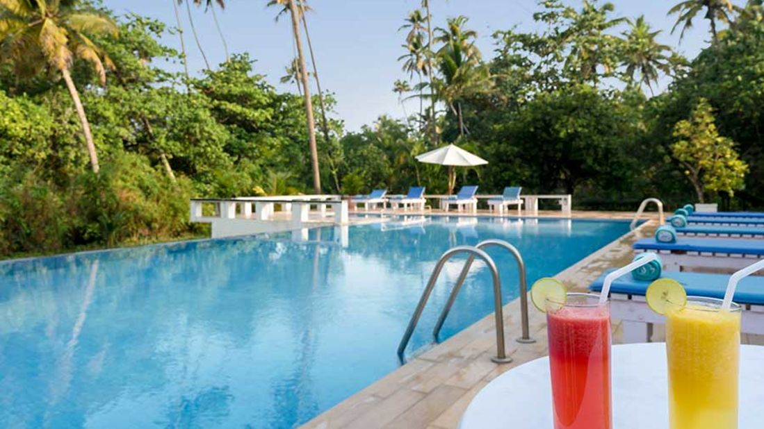 abad-turtle-resort-large-swimming-pool, Contact Beach Resort in Marari, Beach resorts in Allepey, 4 Star Resorts in Alleppey, Best Beach Resorts in Alleppey, Best Beach Resorts Near Cochin, Beach Resorts in Kerala