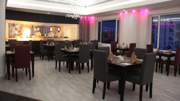Restaurant at Gokulam Park Hotel Convention Centre Cochin