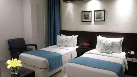 Deluxe Room Rockland Hotel Chittaranjan Park New Delhi Hotel in CR Park 2