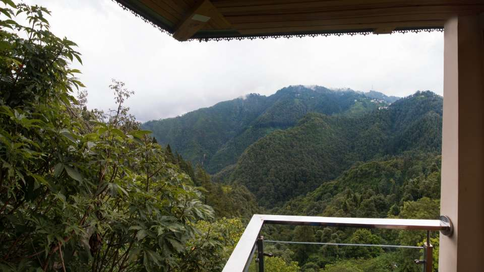 hotels at Mussoorie on Mall Road, Private balcony at our hotel near Mossy Falls, Hotel Pacific Mussoorie