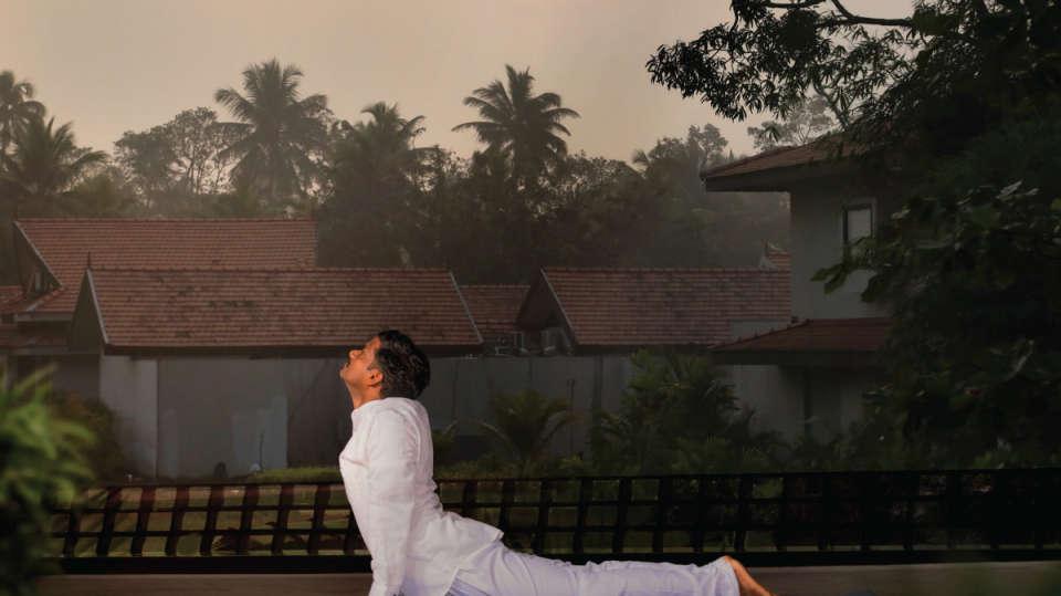 Yoga-Early-Morning-Niraamaya-Retreats-Kumarakom-Luxury-Resort-Vembanad-Lake