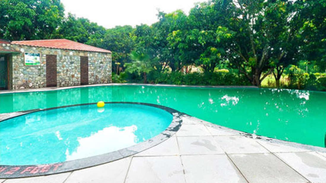 Swimming Pool at Premium Suite at Corbett Wild Iris Spa Resort
