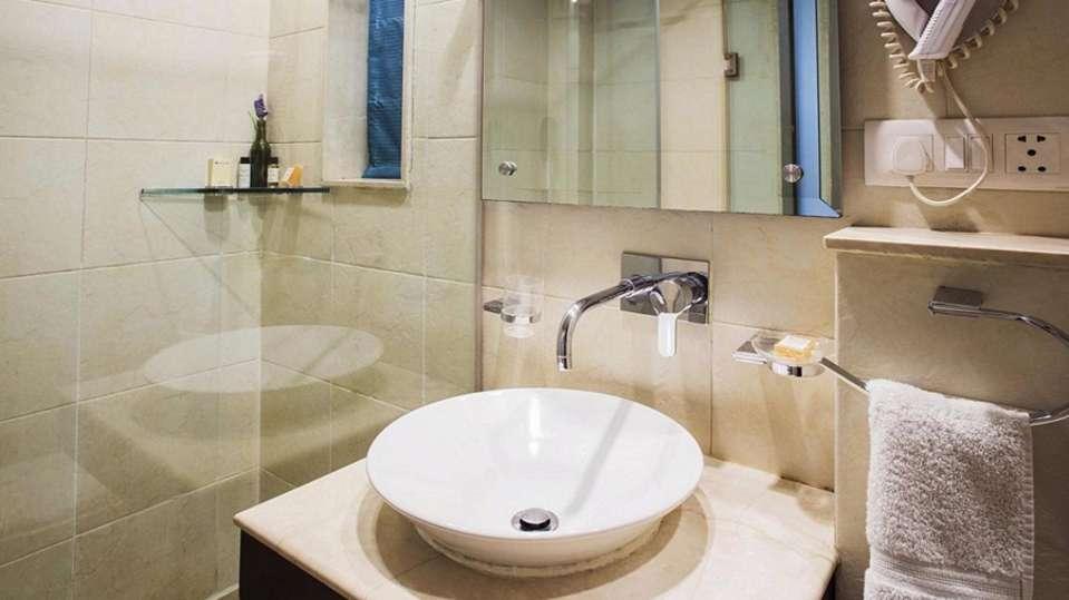 Deluxe Room Rockland Hotel Chittaranjan Park New Delhi Hotel in CR Park 4