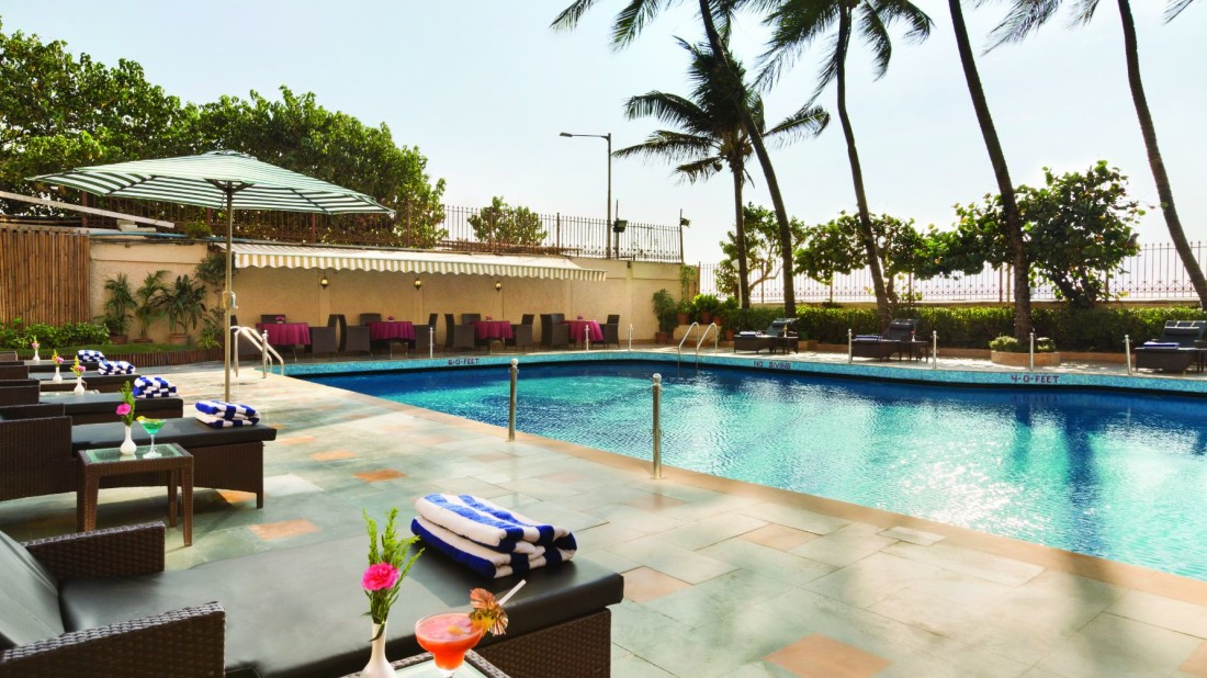 Pool side Patio at Hotel Ramada Plaza Palm Grove, Juhu Beach, Pool Side Restaurant in Juhu