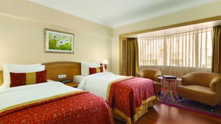Deluxe Room at Hotel Ramada Plaza Palm Grove Juhu Beach Mumbai