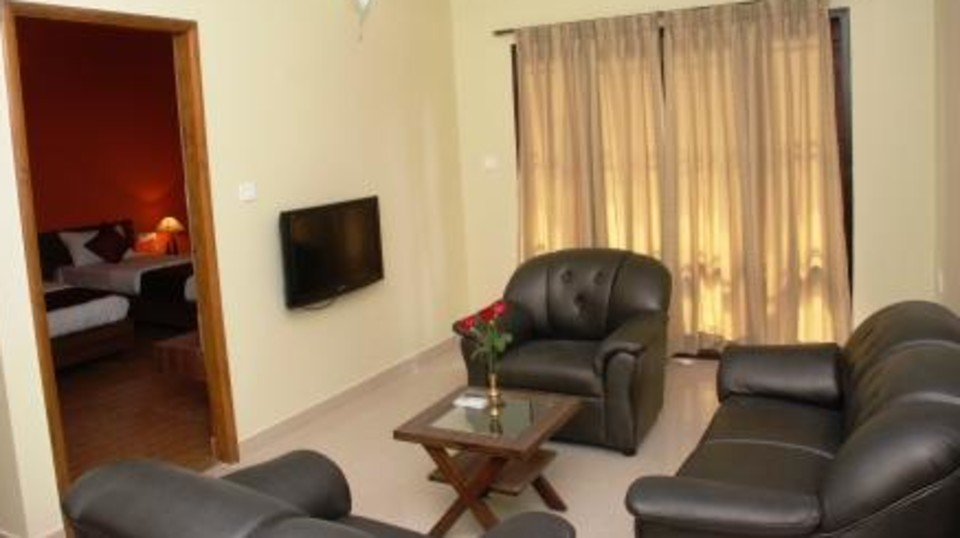Hotel Arama Suites Bangalore living   bedroom area aqua suite hotel arama suites bangalore