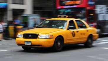 selective-focus-photography-of-yellow-sedan-1310781
