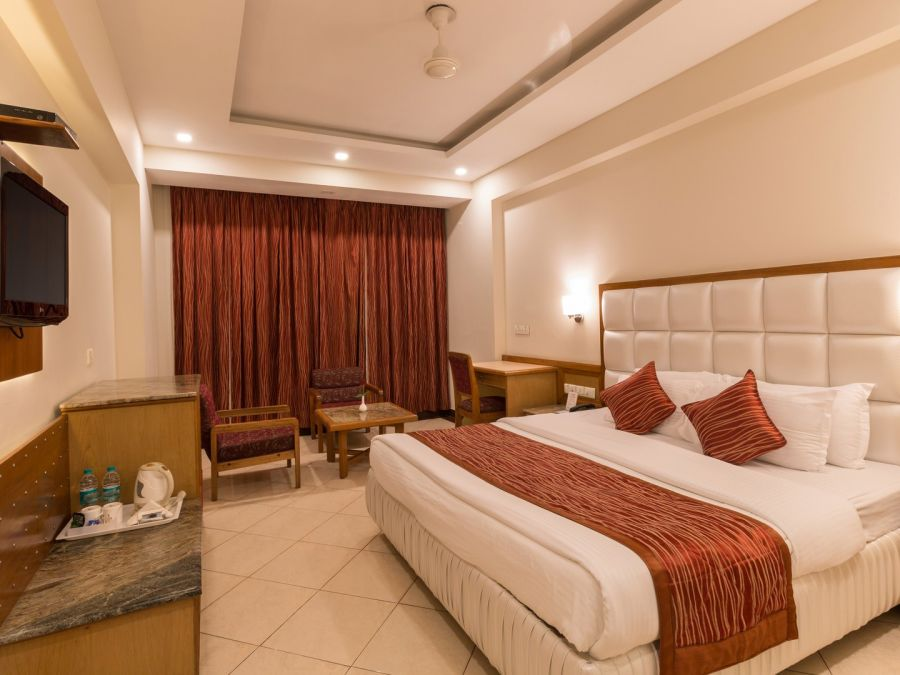 alt-text Super Deluxe Room, Hotel Pacific Dehradun, hotel rooms near the Clock Tower