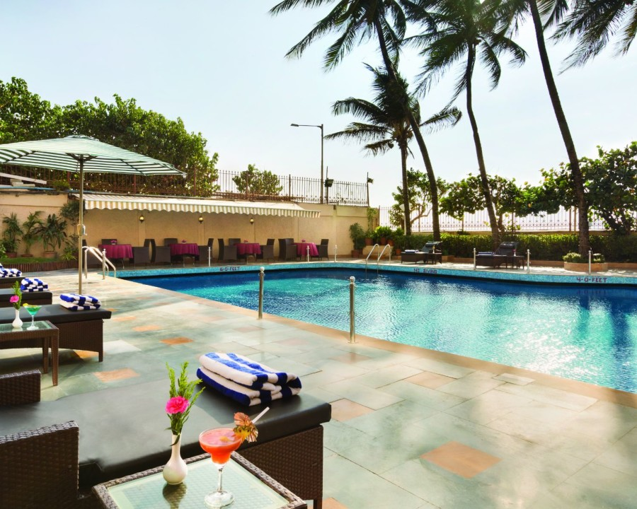 alt-text Pool side Patio at Hotel Ramada Plaza Palm Grove, Juhu Beach, Pool Side Restaurant in Juhu