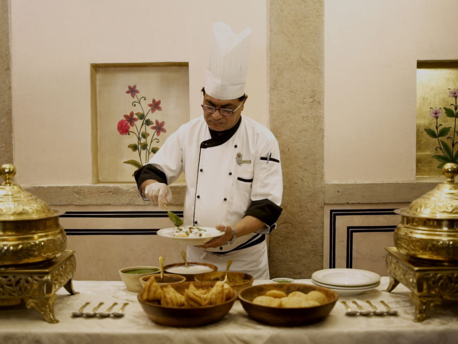 alt-text 29. Chef preparing Local delicacies