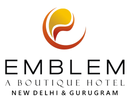 Emblem Hotel, Hero Honda Chowk Gurugram Gurugram logo white