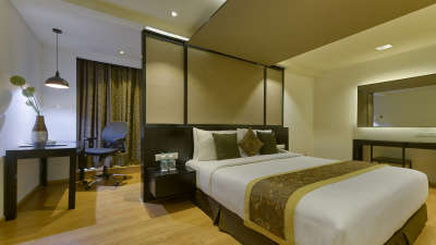 DELUXE SUITE BED ROOM at Davanam Sarovar Portico Suites Bangalore