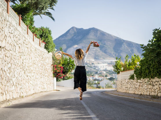 young-beautiful-woman-vacation-jumping-one-hand-sandals-second-hand-hat 72229-147