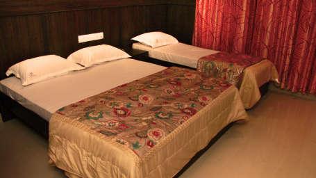 The Signature Inn Hotel, Bangalore Bangalore Deluxe Triple Non Ac Room 1 The Signature Inn Hotel Bangalore
