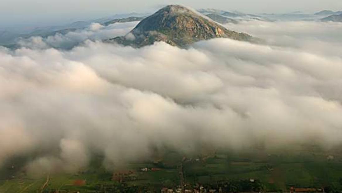 Clouds surrounding  the peak of the Nandi Hills mountain