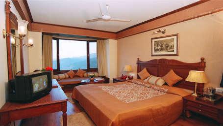 Sun n Snow Inn Hotel Kausani Kausani Deluxe Room Sun n Snow Inn hotels in kausani, Uttarakhand hotels, kausani hotels 5555