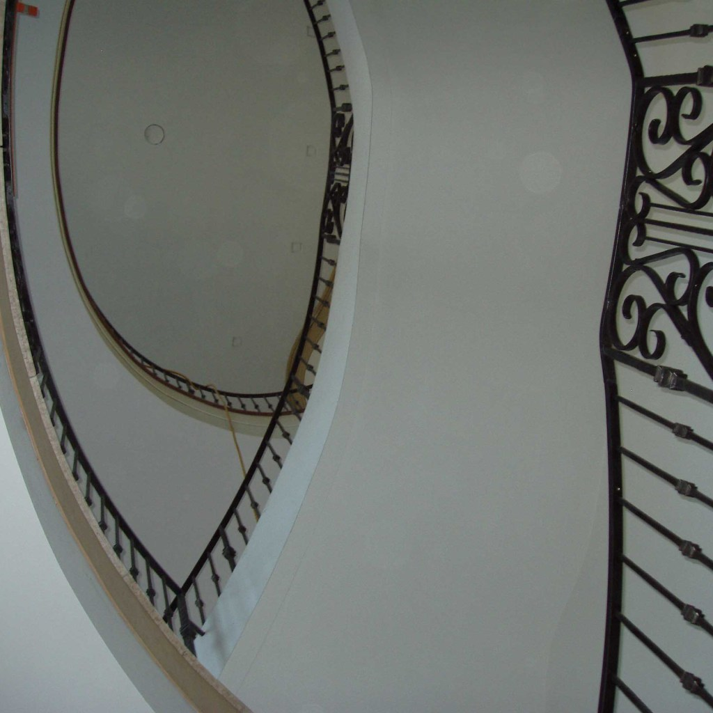 hand wrought iron panels placed strategicaly in this stair railing