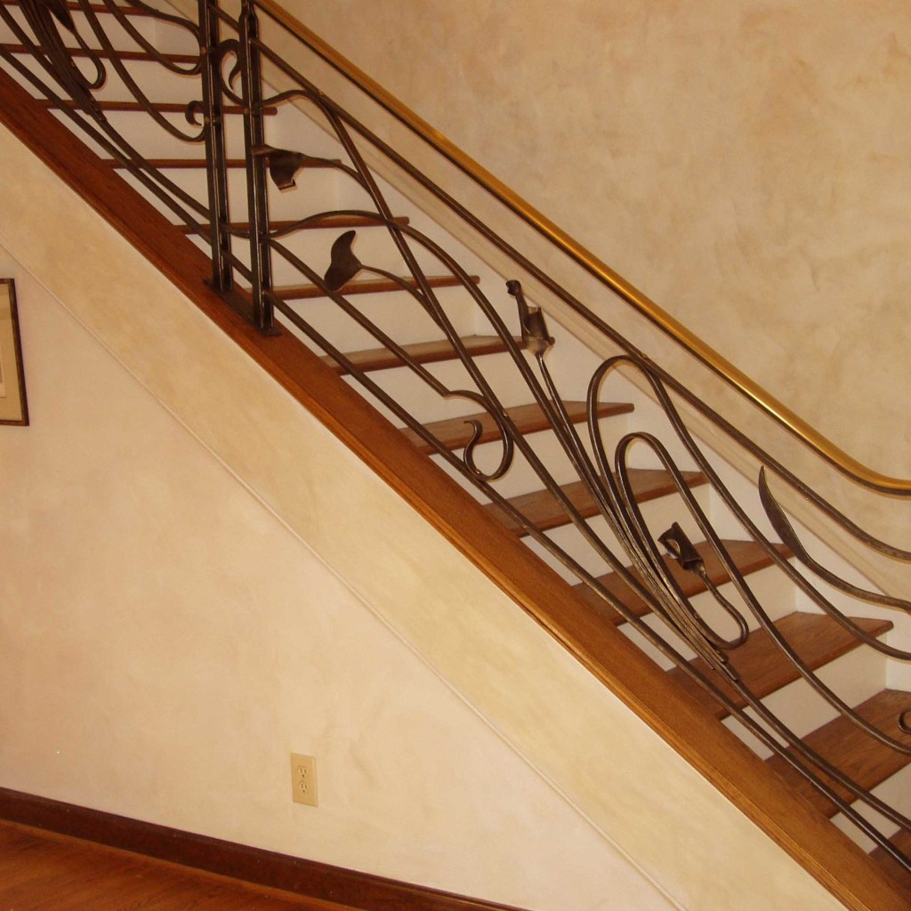 Custom stair rail with bronze cap and iron filigree set in Chapel Hill NC