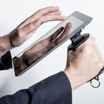 As tablets become less expensive, more available to the masses we are sure there will be some people who would like a unique way to hold their electronic tablet computer with a pistol style grip.