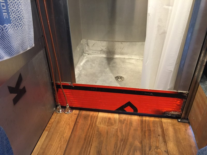Genius: repurposed road sign for the shower pan in the Firebird tiny house by Eric Bohne