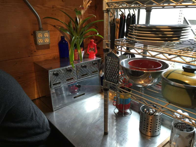 A vintage spice rack in the Firebird tiny house by Eric Bohne