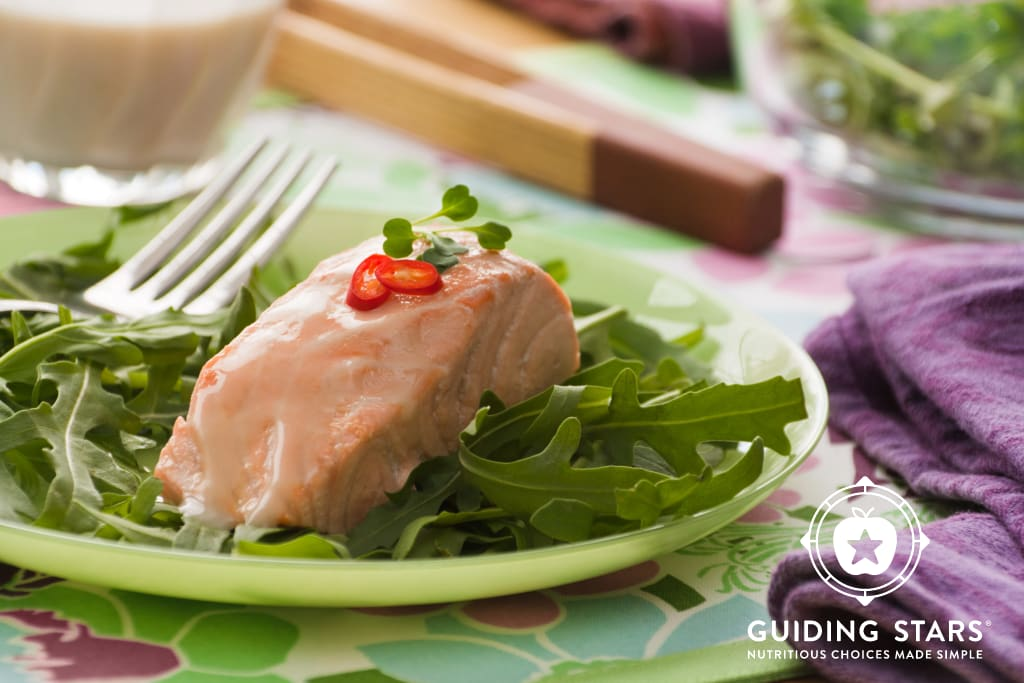 Poached Coconut Salmon Over Greens