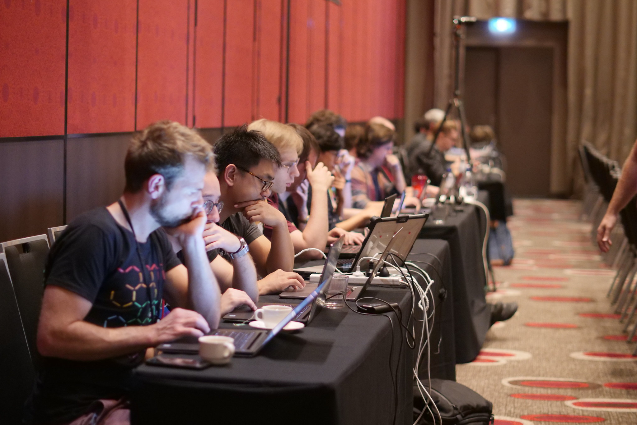 Attendees in a Lambda Jam workshop working on their laptops
