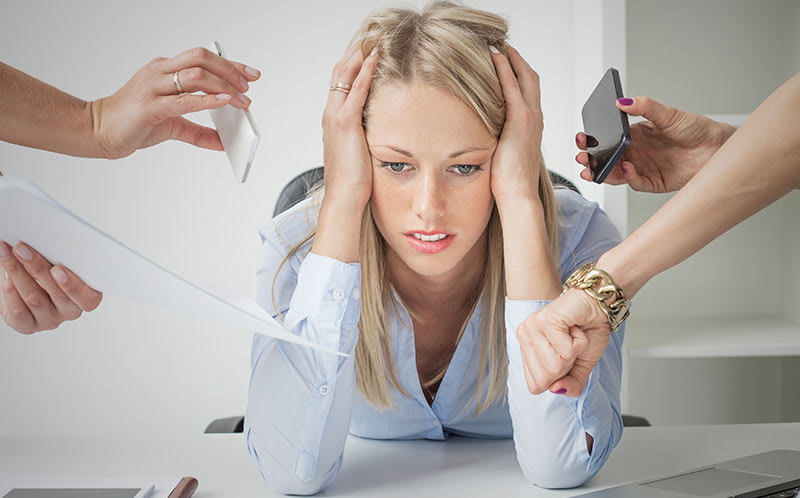 Businesswoman surrounded by stressors