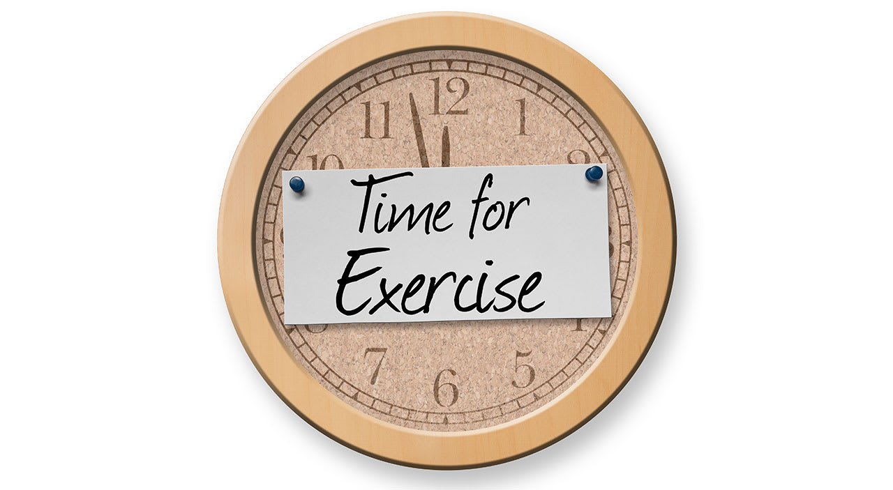 Clock with time for exercise written on it.