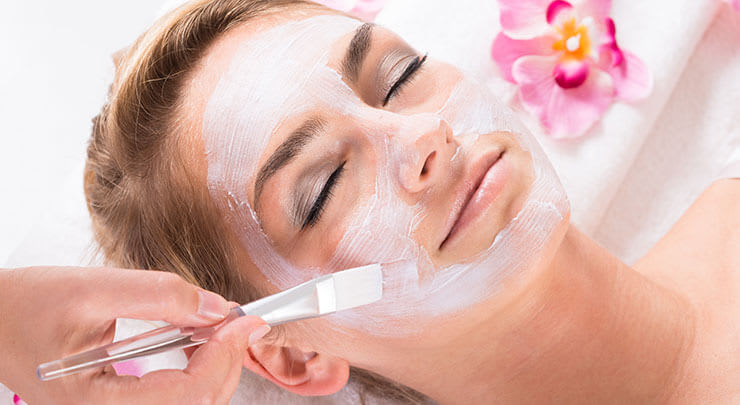 Woman getting chemical peel treatment.