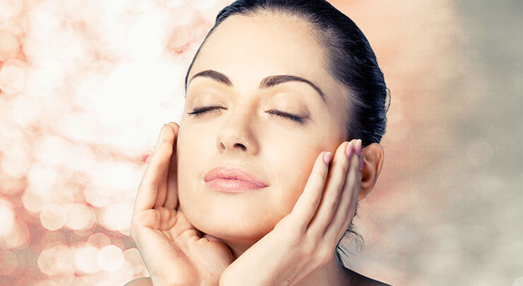 Woman looking up with eyes closed and feeling smooth skin after chemical peel.