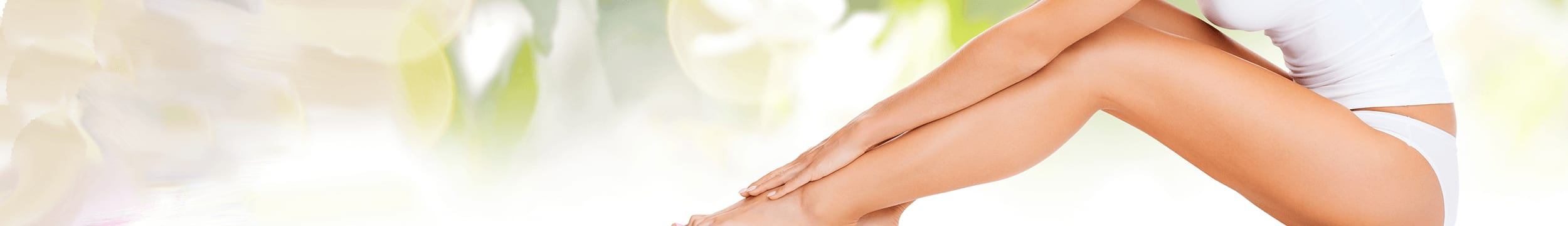 woman in white tank showing off smooth legs after laser hair removal