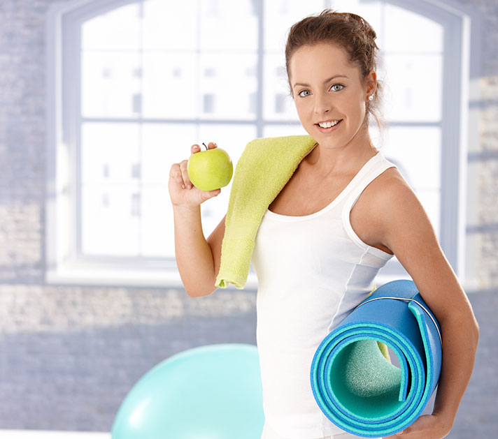 Woman eating apple after working out.