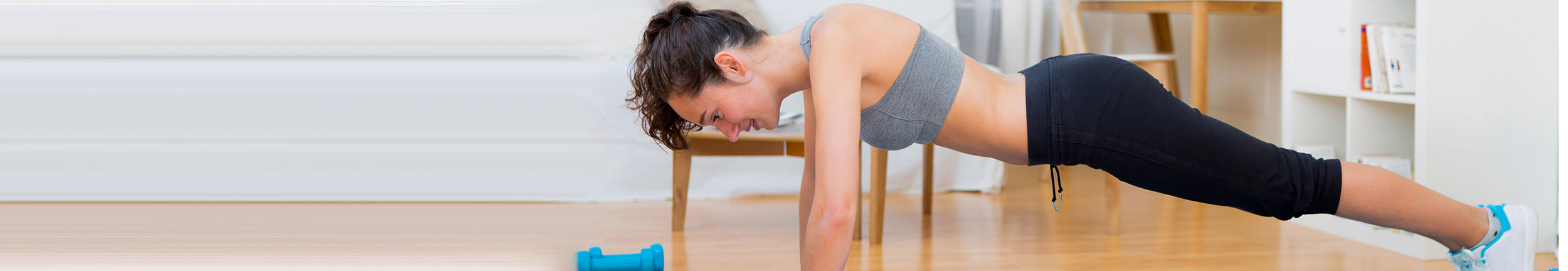 Woman doing plank to help her CoolSculpting results on her stomach.